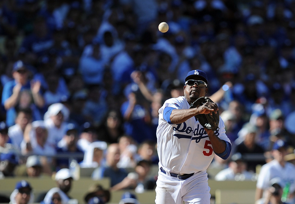 . Los Angeles Dodgers\' Juan Uribe throws an out to first in the sixth during game 5 of the NLCS at Dodger Stadium Wednesday, October 16, 2013. (Photo by Hans Gutknecht/Los Angeles Daily News)