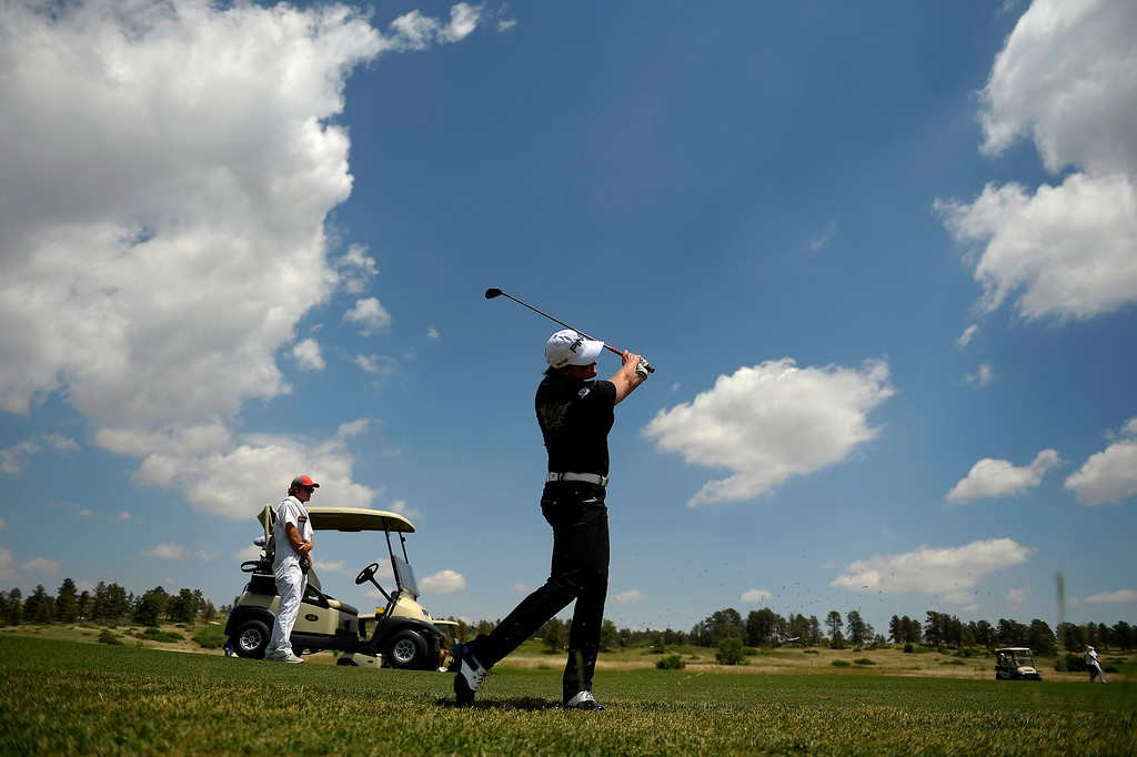 . Maria Hjorth, representing Sweden, nails a shot on the fairway while practicing with the 2013 European Solheim Cup Team on the course at Colorado Golf Club in Parker, Colorado. (Photo By Joe Amon/The Denver Post)