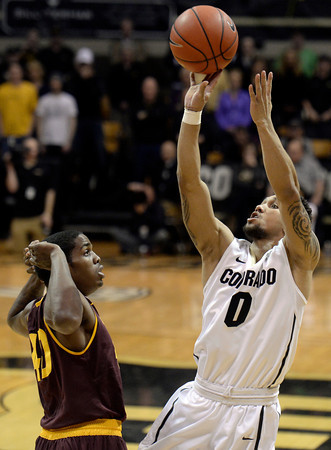 . Colorado\'s Askia Booker takes a shot over Shaquielle McKissic during a game against Arizona State on Wednesday, Feb. 19, in Broomfield, Colorado.  Jeremy Papasso/Boulder Daily Camera