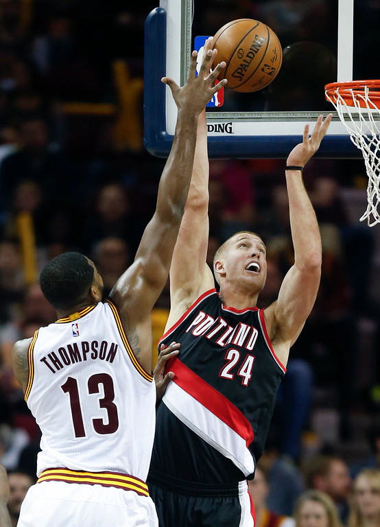 . Portland Trail Blazers\' Mason Plumlee (24) scores against Cleveland Cavaliers\' Tristan Thompson (13) during the first half of an NBA basketball game, Wednesday, Nov. 23, 2016, in Cleveland. (AP Photo/Ron Schwane)