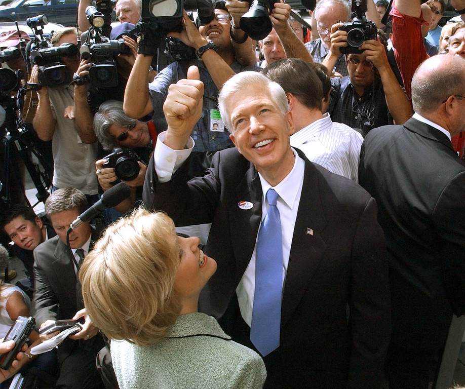 . 10/07/03--WEST HOLLYWOOD--Califonia Gov. Gray Davis and wife Sharon wave to supporters after casting their ballots in West Hollywood at their polling place during the California recall election Tuesday, October 7th, 2003. (Gus Ruelas/LA Daily News)