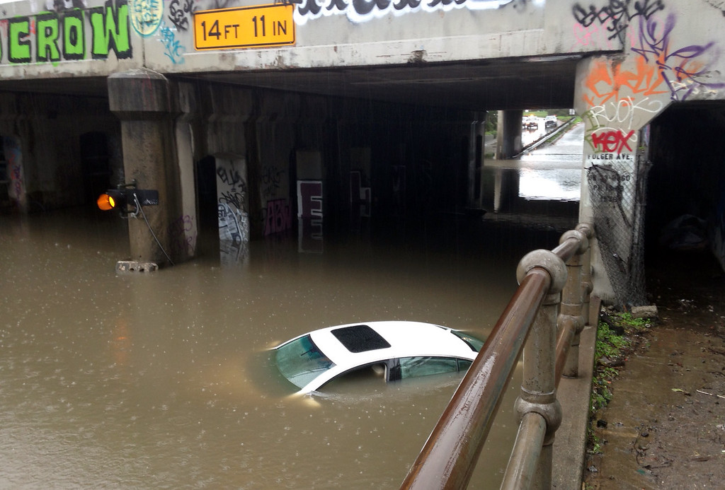 . A car is submerged in floodwaters on Ashby Avenue under Interstate 80 in Berkeley, Calif., on Thursday, Dec. 11, 2014. (Kristopher Skinner/Bay Area News Group)