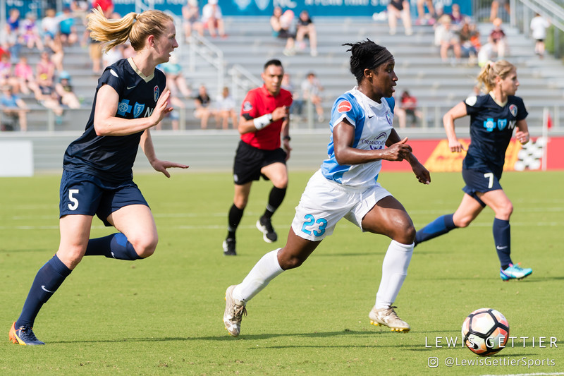 Samantha Mewis (5) gives chase to Jasmyne Spencer (23) during a match between the NC Courage and the Orlando Pride in Cary, NC in Week 3 of the 2017 NWSL season. Photo by Lewis Gettier.