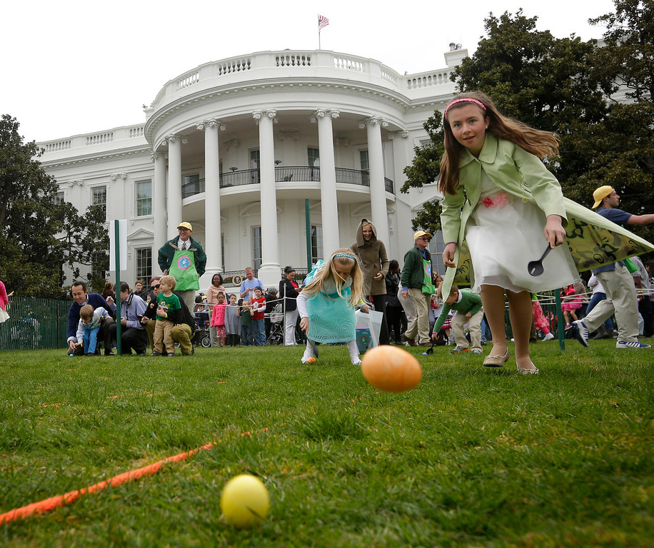 . Kate Heller, 11, right, and other children participate in the annual White House Easter Egg Roll on the South Lawn of the White House in Washington, Monday, April, 1, 2013. (AP Photo/Pablo Martinez Monsivais)