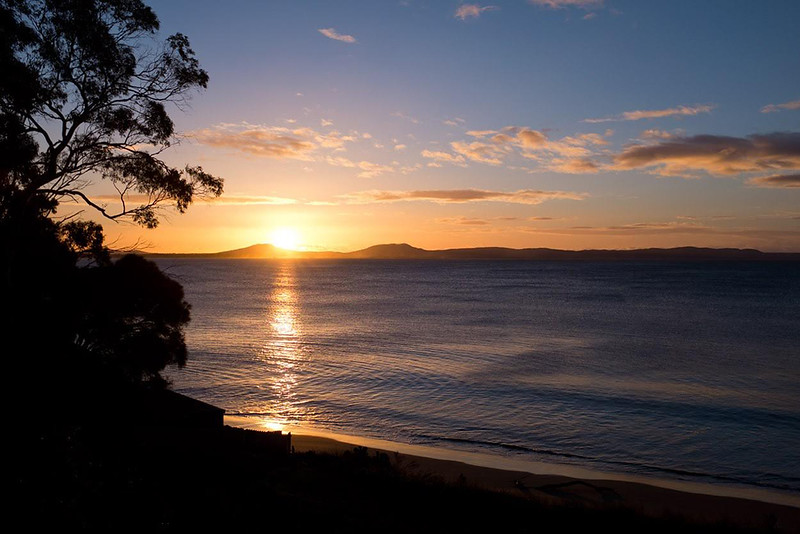 freycinet park tasmania sunset over the ocean
