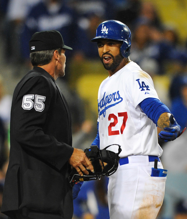 . The Dodgers\' Matt Kemp argues with home plate ump Angel Hernandez after Kemp struck out looking in the ninth inning, Friday, April 25, 2014, at Dodger Stadium. (Photo by Michael Owen Baker/L.A. Daily News)