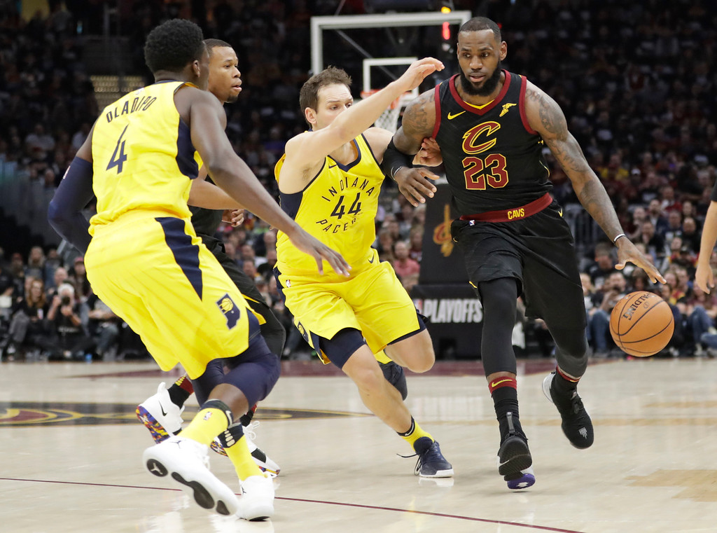 . Cleveland Cavaliers\' LeBron James (23) drives against the Indiana Pacers in the first half of Game 1 of an NBA basketball first-round playoff series, Sunday, April 15, 2018, in Cleveland. (AP Photo/Tony Dejak)
