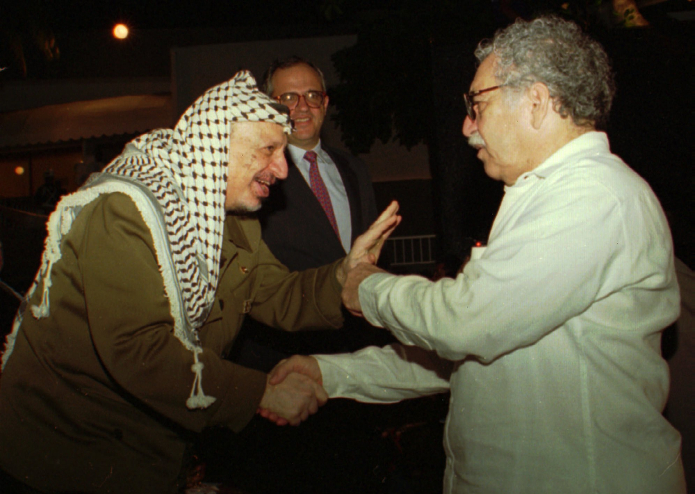 . In this Oct. 20,1995 file photo, PLO Leader Yasser Arafat greets Nobel laureate Colombian Nobel laureate Gabriel Garcia Marquez during the closing ceremonies of the Non-Aligned Summit in Cartagena, Colombia.  In the background is Colombian President Ernesto Samper. Marquez died Thursday April 17, 2014 at his home in Mexico City. (AP Photo/Roger Richards,File)