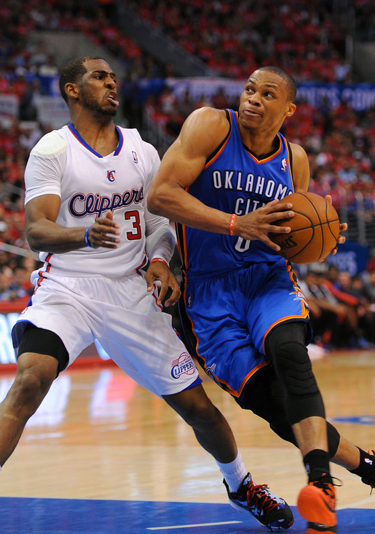 . Thunder point guard Russell Westbrook drives the key on Clippers Chris Paul, Friday, May 9, 2014, at Staples Center. (Photo by Michael Owen Baker/Los Angeles Daily News)