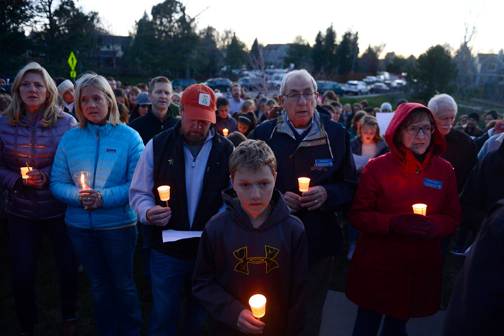 """. Members of the community gather to sing \""""Amazin Grace\"""" during a vigil for Dr. Kenneth Atkinson on April 5, 2016 in Centennial, Colorado. Close to 400 people showed up to pay their respects to Dr. Atkinson, who lost his life trying to protect a woman whose husband shot her. (Photo by Brent Lewis/The Denver Post)"""
