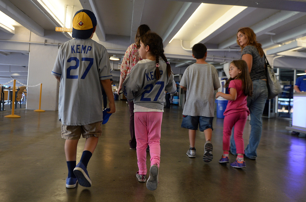 . Children and adults walk through the loge level on the way to their seats as members of the San Fernando Valley Rescue Mission are treated to a Major league baseball game between the Miami Marlins and the Los Angeles Dodgers on Wednesday, May 14, 2014 in Los Angeles. The Mission experienced a devastating fire earlier this month. Damage sustained included the destruction of the San Fernando Valley Rescue Mission�s emergency shelter, vehicle fleet, clothing warehouse and food pantry which were vital in aiding those of need in the San Fernando Valley.  (Keith Birmingham/Pasadena Star-News)