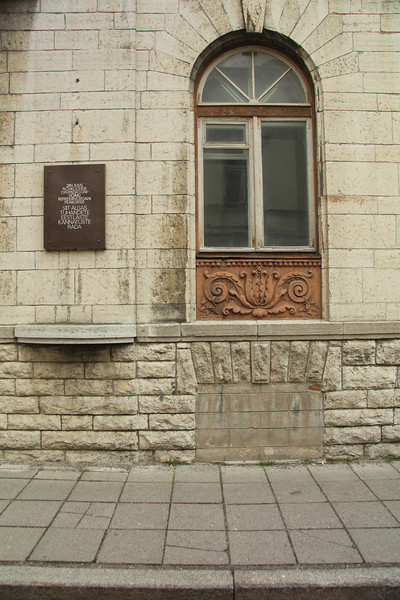 """Notice the bricked-up cellar window of the KGB Building. The plaque reads, """"This building housed the headquarters of the organ of repression of the Soviet occupational power. Here began the road to suffering for thousands of Estonians."""" -Tallinn, Estonia"""