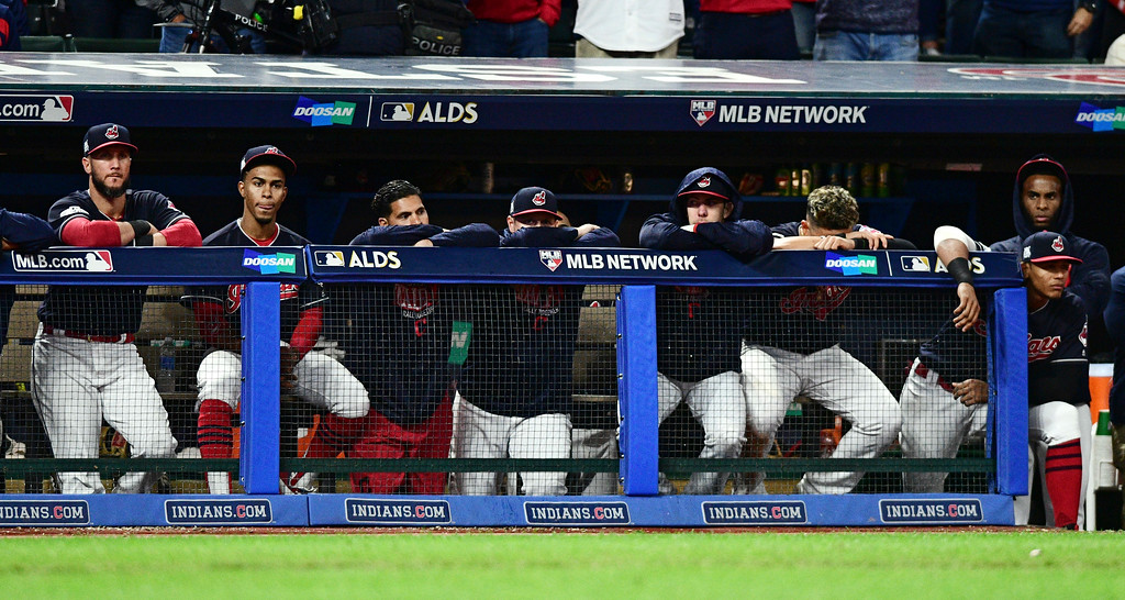 . The Cleveland Indians watch during the ninth inning against the New York Yankees in Game 5 of a baseball American League Division Series, Wednesday, Oct. 11, 2017, in Cleveland. The Yankees won 5-2 and advanced to the ALCS. (AP Photo/David Dermer)
