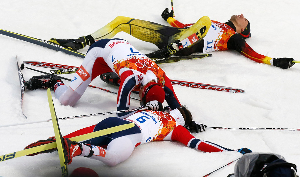 . Norway\'s gold medal winner Joergen Graabak, Norway\'s silver Magnus Hovdal Moan and Germany\'s Bjoern Kircheisen, from front to back, rest after the cross-country portion of the Nordic combined individual Gundersen large hill competition at the 2014 Winter Olympics, Tuesday, Feb. 18, 2014, in Krasnaya Polyana, Russia. (AP Photo/Dmitry Lovetsky)