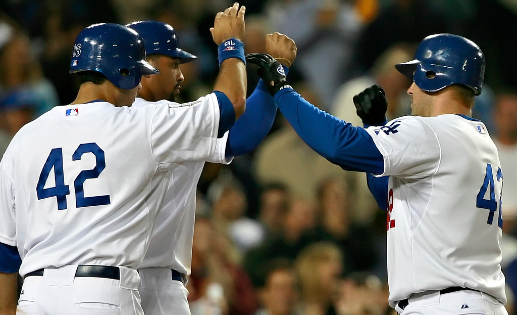 . After hitting a homer in the bottom of fifth inning, Dodgers\' Jeff Kent, right, high-fives his teammates in a game against the Pittsburgh Pirates on Tuesday, April 15, 2008 at Dodger Stadium. The Dodgers  wore the number 42 to honor Jackie Robinson. (Los Angeles  Daily News file photo)