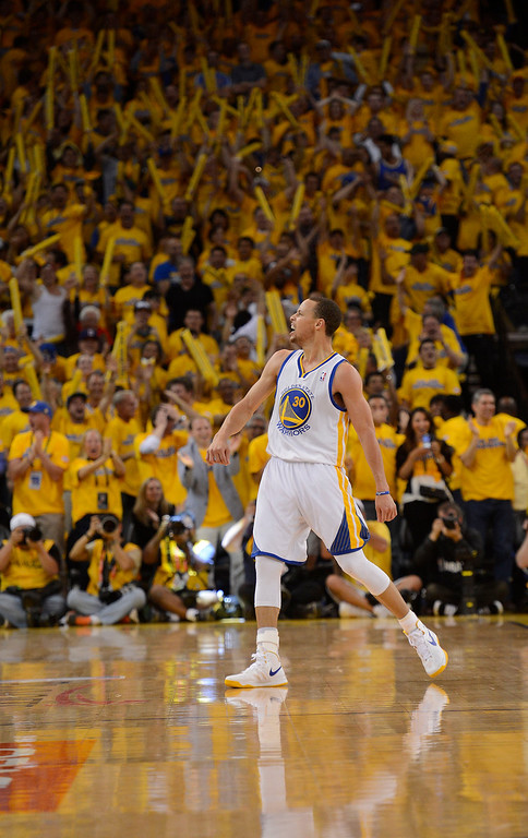 . Stephen Curry (30) of the Golden State Warriors celebrates during the fourth quarter in Game 4 of the first round NBA Playoffs April 28, 2013 at Oracle Arena. (Photo By John Leyba/The Denver Post)