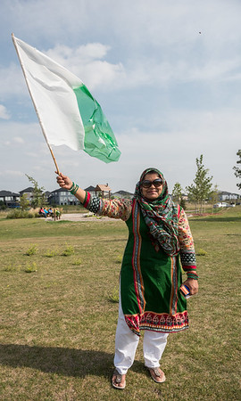 DAVID LIPNOWSKI / WINNIPEG FREE PRESS  Nuzhat Farooqui poses with Pakistan's flag at Jinnah Park prior to the beginning of festivities celebrating Pakistan's Independence Day and Eid Sunday August 19, 2018.