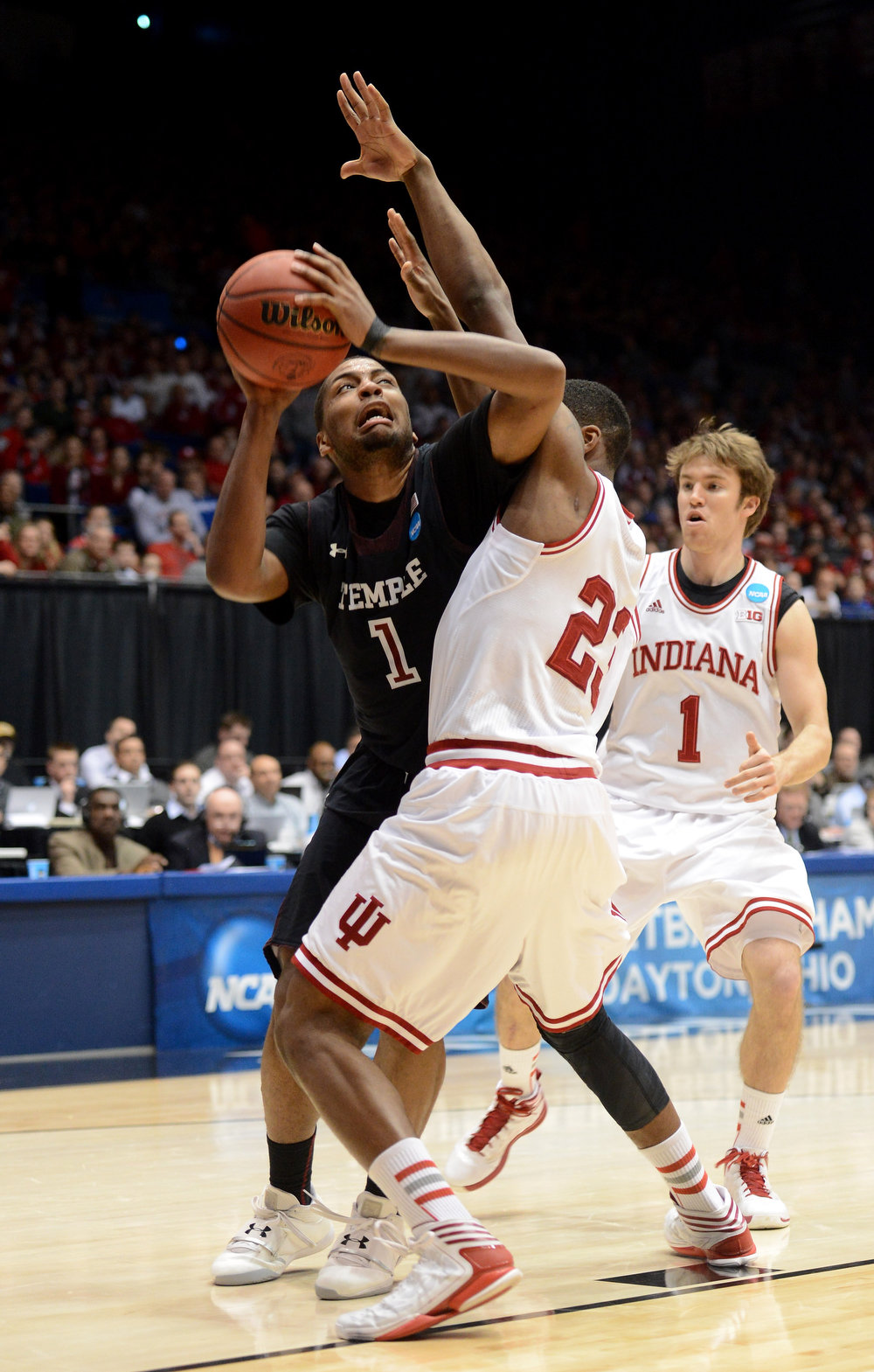 . Khalif Wyatt #1 of the Temple Owls handles the ball against Remy Abell #23 of the Indiana Hoosiers in the second half during the third round of the 2013 NCAA Men\'s Basketball Tournament at UD Arena on March 24, 2013 in Dayton, Ohio.  (Photo by Jason Miller/Getty Images)