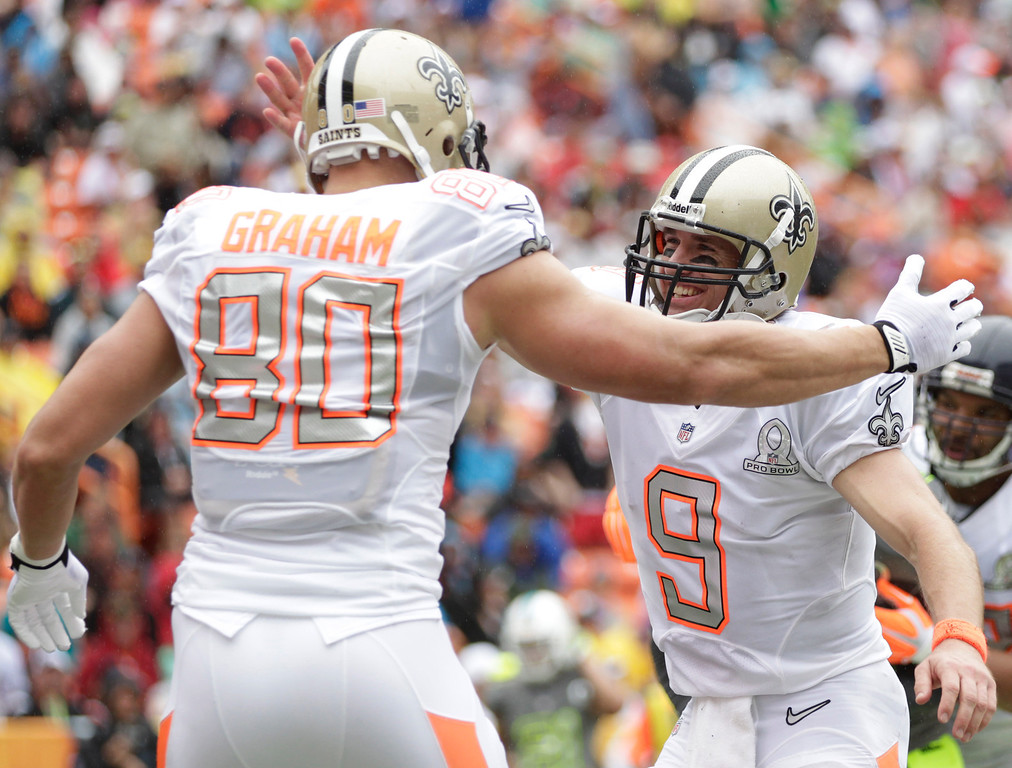 . New Orleans Saints tight end Jimmy Graham (80) is congratulated by New Orleans Saints quarterback Drew Brees (9) of Team Rice after catching a pass for a touchdown in the second quarter quarter of the NFL Pro Bowl football game Sunday, Jan. 26, 2014, in Honolulu. (AP Photo/Eugene Tanner)
