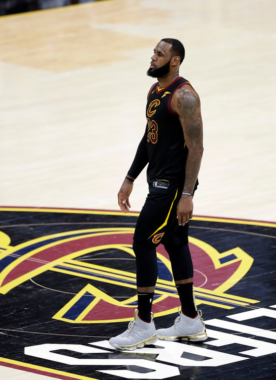 . Cleveland Cavaliers\' LeBron James watches from center court in the second half of Game 3 of basketball\'s NBA Finals, Wednesday against the Golden State Warriors, June 6, 2018, in Cleveland. The Warriors defeated the Cavaliers 110-102 to take a 3-0 lead in the series. (AP Photo/Tony Dejak)