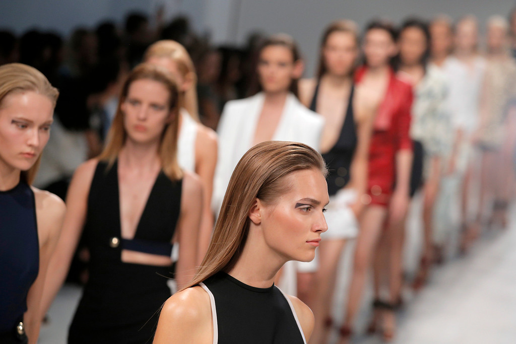 . Models present creations as part of Italian fashion designer Anthony Vaccarello\'s ready-to-wear Spring/Summer 2014 fashion collection presented in Paris, Tuesday, Sept. 24, 2013. (AP Photo/Christophe Ena)