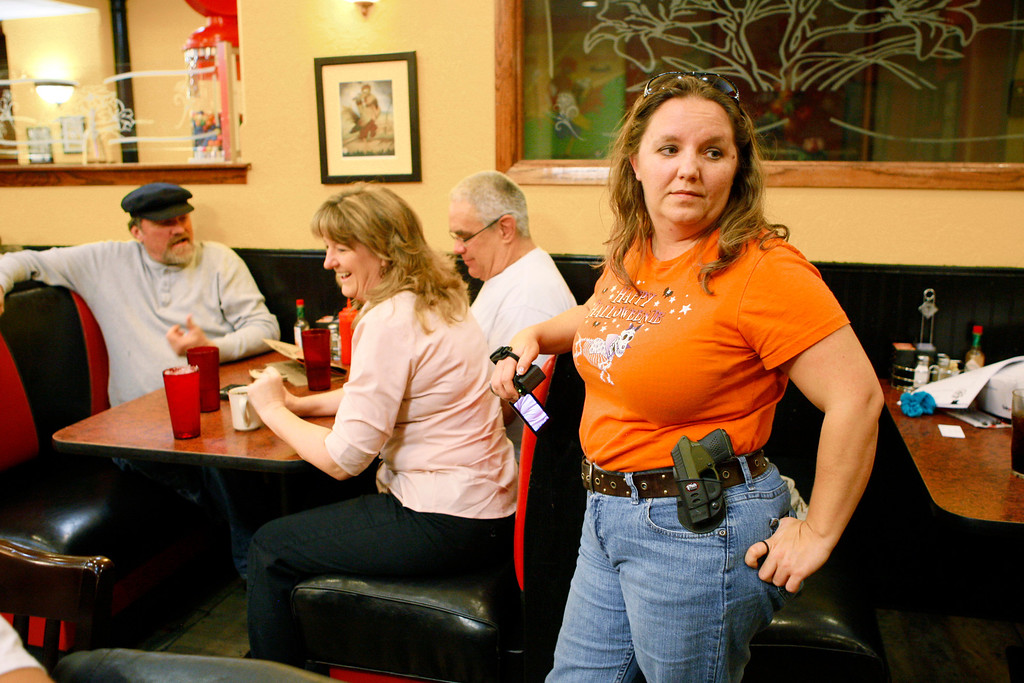 . Morgan Meritt of Del City, Oklahoma, joins other members of the Oklahoma Open Carry Association (OKOCA) wearing unconcealed side arms as they gather at Beverly\'s Pancake House in Oklahoma City November 1, 2012. A new Oklahoma law took effect November 1 allowing anyone with a concealed weapon license to carry their firearms openly in a holster or belt.   REUTERS/Bill Waugh