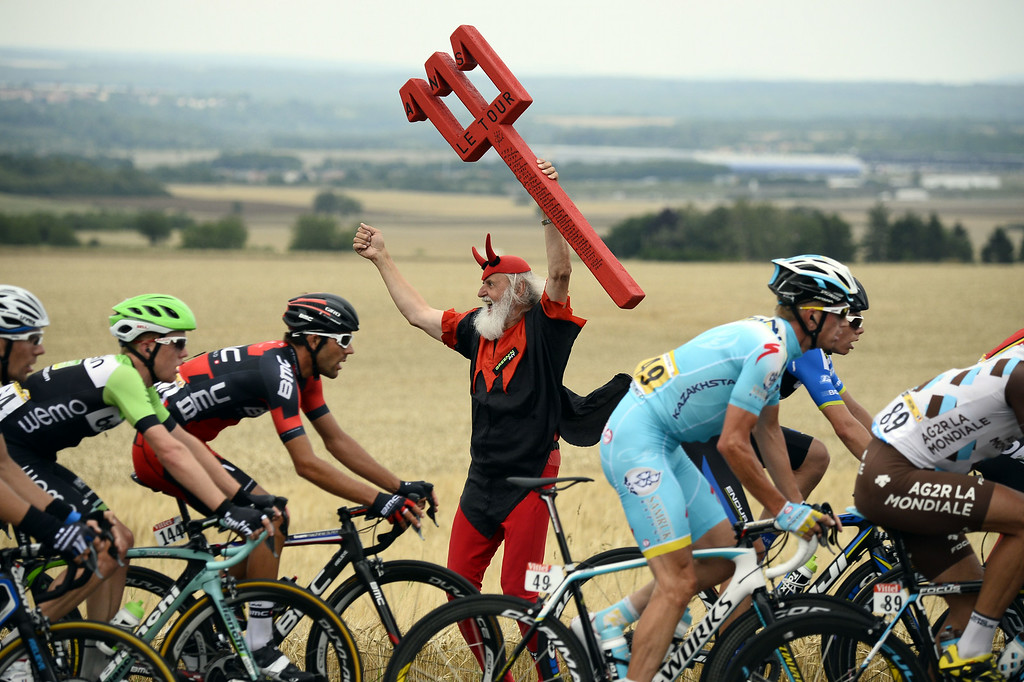 . German fan Didi Senft known as El Diablo cheers as the pack rides past during the 234.5 km seventh stage of the 101st edition of the Tour de France cycling race on July 11, 2014 between Epernay and Nancy, northeastern France.  AFP PHOTO / LIONEL BONAVENTURE/AFP/Getty Images