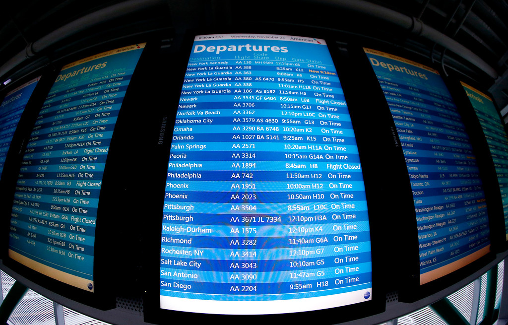 . A screen displays flight status information at O\'Hare International Airport in Chicago, Wednesday, Nov. 23, 2016. While driving remains the most popular form of transportation Thanksgiving travelers take, AAA expects just under 4 million people to fly to their holiday destinations. (AP Photo/Nam Y. Huh)