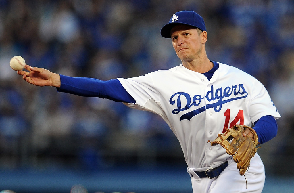 . Los Angeles Dodgers second baseman Mark Ellis throws out San Diego Padres\' Chris Denorfia (not pictured) in the first inning of their baseball game on Wednesday, April 17, 2013 in Los Angeles.   (Keith Birmingham/Pasadena Star-News)