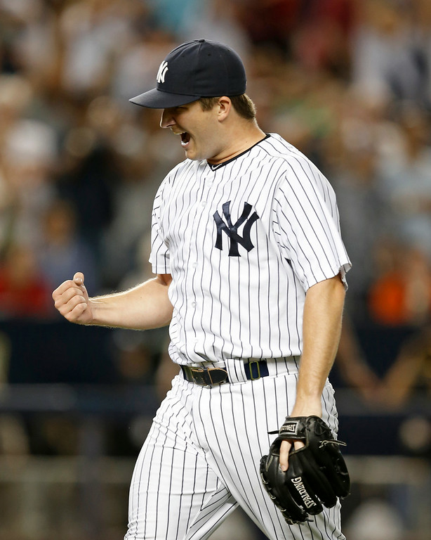 . RETRANSMISSION TO CORRECT INNING - New York Yankees relief pitcher Adam Warren (43) reacts after pitching out of a eighth inning jam in a baseball game against the Detroit Tigers at Yankee Stadium in New York, Wednesday, Aug. 6, 2014.  Warren was the winning pitcher in the Yankees 5-1 victory over the Tigers. (AP Photo/Kathy Willens)