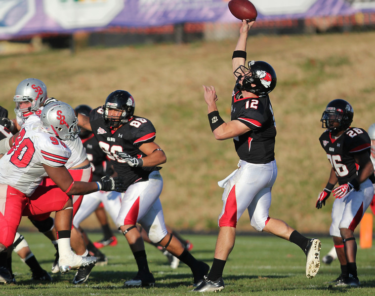 Chandler Browning, 12, throws the ball.
