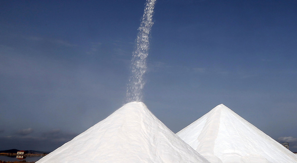 . Large salt piles are seen at a production site in Messolongi, western Greece. Salt lakes at Messolongi are used for production by solar evaporation. The facilities are the largest saltworks in Greece, and are located at a protected wetland complex of estuaries and lagoons. (AP Photo/Dimitri Messinis)
