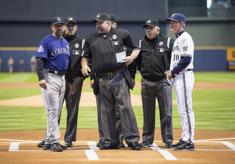 . Walt Weiss #22 manager of the Colorado Rockies and Ron Roenicke #10 of the Milwaukee Brewers stand with the umpires on opening day at Miller Park on April 1, 2013 in Milwaukee, Wisconsin.  (Photo by Tom Lynn/Getty Images)