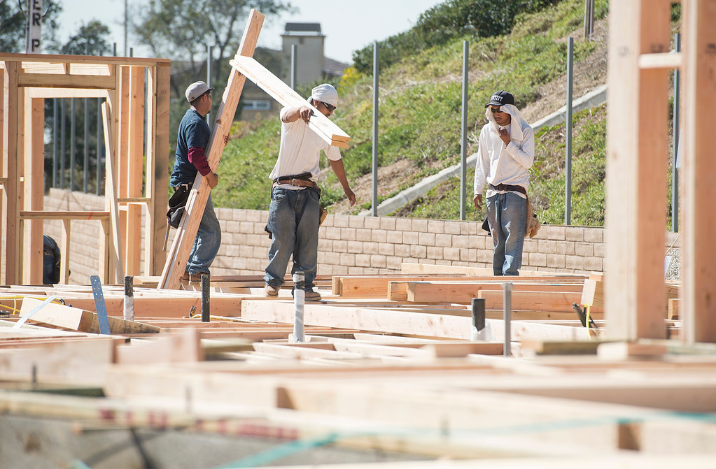 . Workers build single-family homes at the Rosedale housing project in Azusa Feb. 26, 2013.  (SGVN/Staff photo by Leo Jarzomb)