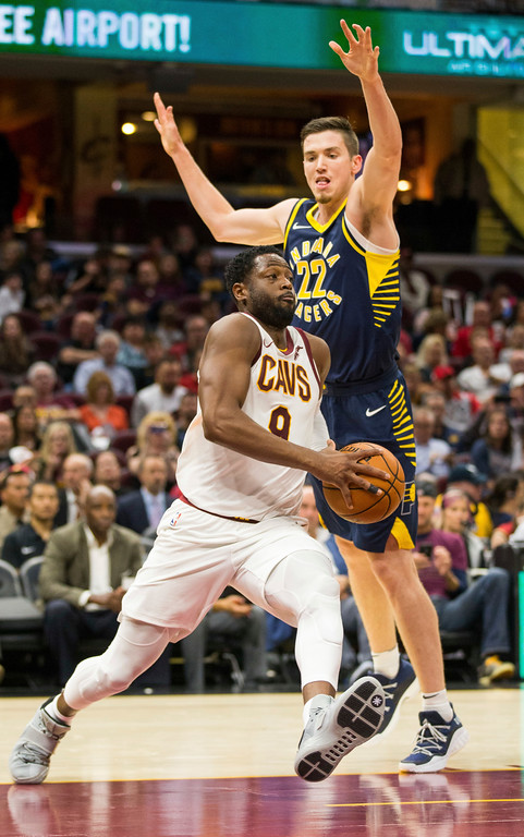 . Cleveland Cavaliers\' Dwyane Wade (9) dribbles around Indiana Pacers\' T.J. Leaf (22) during the second quarter of an NBA preseason basketball game, Friday, Oct. 6, 2017, in Cleveland. (AP Photo/Scott R. Galvin)