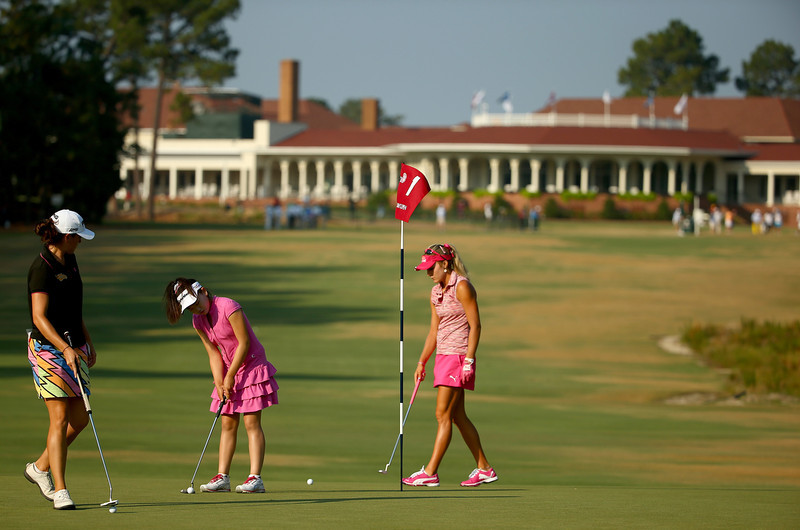 . Eleven-year old Amateur Lucy Li of the United States practices alongside Lexi Thompson of the United States during a practice round prior to the start of the 69th U.S. Women\'s Open at Pinehurst Resort & Country Club, Course No. 2 on June 18, 2014 in Pinehurst, North Carolina.  (Photo by Streeter Lecka/Getty Images)