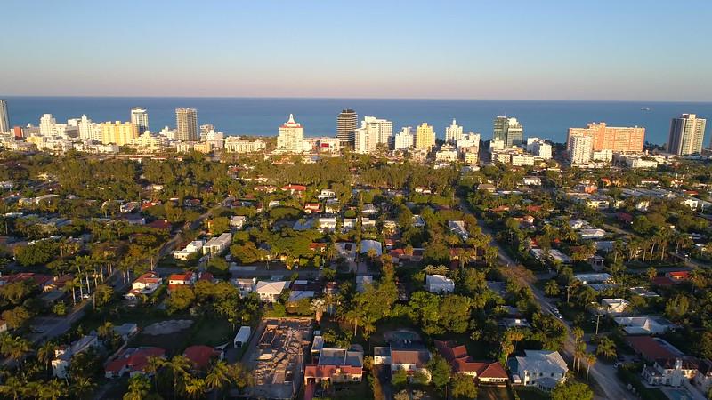 Aerial Miami Beach push in establishing shot showing condos on the beach