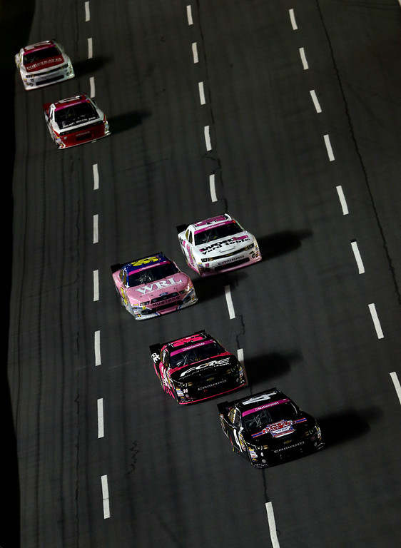 . CONCORD, NC - OCTOBER 11:  Landon Cassill, driver of the #4 Oskar Blues Brewery Chevrolet, leads a pack of cars during the NASCAR Nationwide Series Dollar General 300 at Charlotte Motor Speedway on October 11, 2013 in Concord, North Carolina.  (Photo by Streeter Lecka/Getty Images)