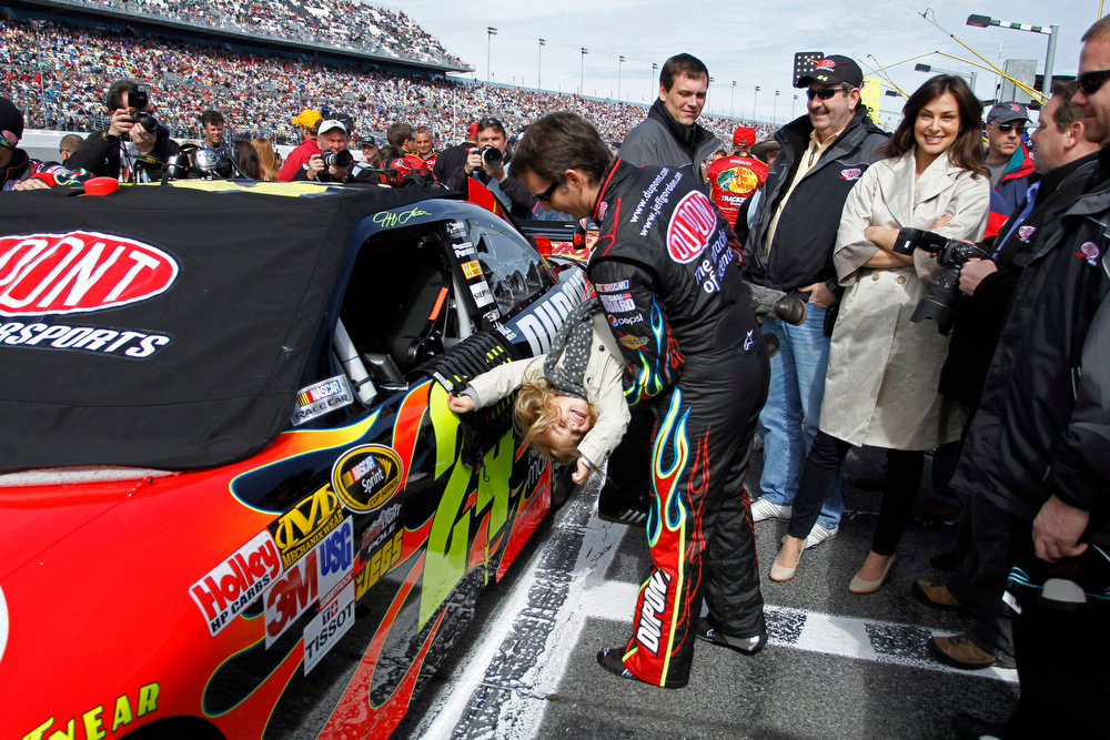 Description of . NASCAR driver Jeff Gordon plays with daughter, Ella Sofia, before the Gatorade Duel at Daytona auto race in Daytona Beach, Fla. Thursday, Feb. 11, 2010. (AP Photo/J Pat Carter)