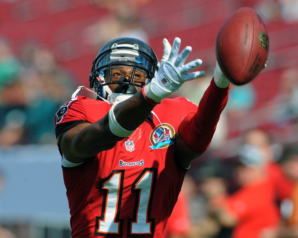 . TAMPA, FL - DECEMBER 9: Wide receiver Tiguan Underwood #11 of the Tampa Bay Buccaneers stretches for a warmup pass against the Philadelphia Eagles December 9, 2012 at Raymond James Stadium in Tampa, Florida.  The Eagles won 23 - 21. (Photo by Al Messerschmidt/Getty Images)