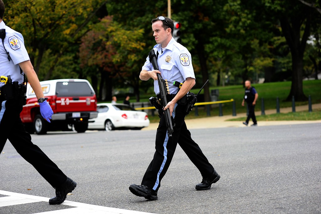 """. Police react after shots fired were reported near 2nd Street NW and Constitution Avenue on Capitol Hill in Washington, DC, on October 3, 2013.  The US Capitol was placed on security lockdown Thursday after shots were fired outside the complex, senators said. \""""Shots fired outside the Capitol. We are in temporary lock down,\"""" Senator Claire McCaskill said on Twitter. Police were seen running within the Capitol building and outside as vehicles swarmed to the scene. AFP Photo/Jewel SAMAD/AFP/Getty Images"""
