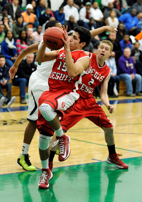 . Regis guard George Kyriazi (15) grabbed a rebound in the first half. The Overland High School boy\'s basketball team defeated Regis Jesuit 80-66 Tuesday night, December 11, 2012.  Karl Gehring/The Denver Post