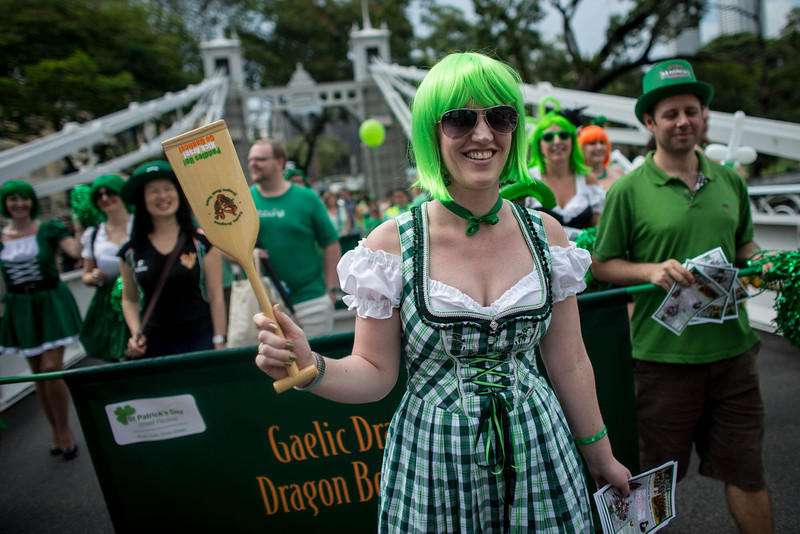 . People participate in the St. Patrick\'s Day parade at Boat Quay on March 17, 2013 in Singapore.  Singapore\'s Irish community gathered at Boat Quay for a three-day-long St Patrick\'s Day Street Festival which featured street performances, buskers, and Irish food and drink.  (Photo by Chris McGrath/Getty Images)