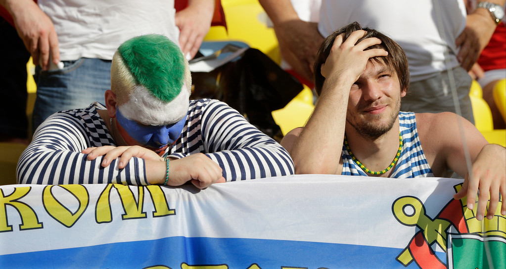 . Russian supporters react after Belgium beat Russia 1-0 in the group H World Cup soccer match between Belgium and Russia at the Maracana Stadium in Rio de Janeiro, Brazil, Sunday, June 22, 2014. (AP Photo/Christophe Ena)
