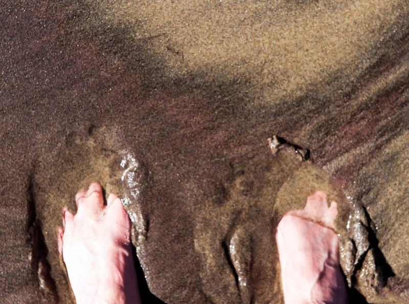 Toes in sand.  A slice of shear heaven.  And ,the purple of the sand matches the purple of my toes, not that you can see it in this image!