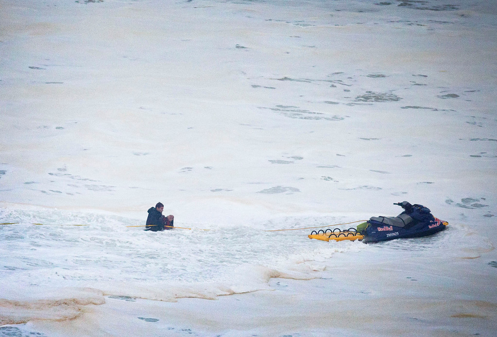 . Brazilian surfer Carlos Burle, left, rescues fellow surfer Maya Gabeira, also from Brazil who nearly drowned after falling trying to ride a big wave at the Praia do Norte, north beach, at the fishing village of Nazare in Portugal\'s Atlantic coast Monday, Oct. 28 2013.  Gabeira was taken to hospital and is reportedly doing well despite suffering a broken ankle. (AP Photo/Miguel Barreira)