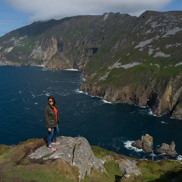 Woman at the edge of Bunglass Point, County Donegal, Ireland