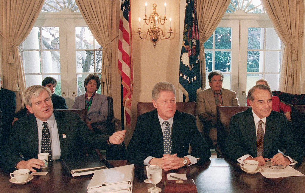 . In this Dec. 31, 1995, file photo, President Bill Clinton meets with House Speaker Newt Gingrich of Ga., left, and Senate Majority Leader Bob Dole of Kansas,  to grapple with competing balanced budget plans. (AP Photo/Greg Gibson, File)
