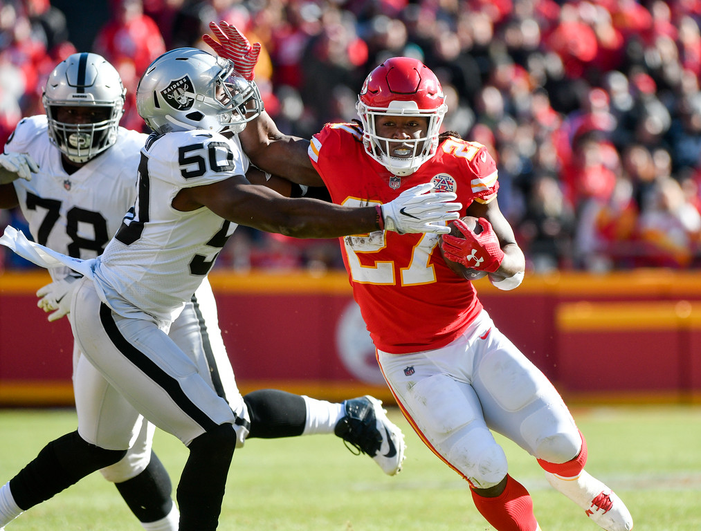 . Kansas City Chiefs running back Kareem Hunt (27) is tackled by Oakland Raiders linebacker Nicholas Morrow (50) during the first half of an NFL football game against the Oakland Raiders in Kansas City, Mo., Sunday, Dec. 10, 2017. (AP Photo/Ed Zurga)