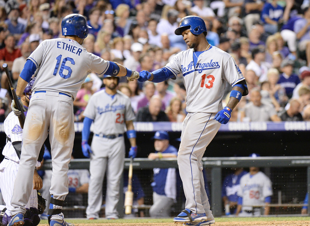 . DENVER, CO. - July 03: Hanley Ramirez of Los Angeles Dodger (13) celebrate his home run with Andre Ethier (16) in the 9th inning of the game against Colorado Rockies at Coors Field. Denver, Colorado. July 3, 2013. Los Angeles won 10-8. (Photo By Hyoung Chang/The Denver Post)